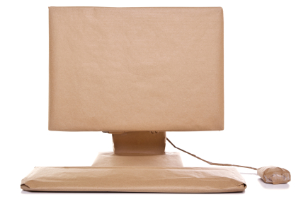 Computer wrapped in brown paper