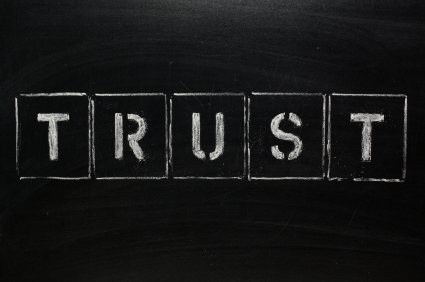 Trust written on blackboard
